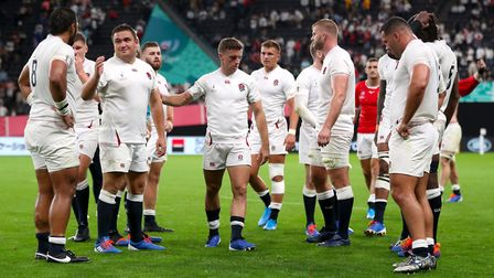 England's George Ford (centre) and team mates after the final whistle of the 2019 Rugby World Cup Po