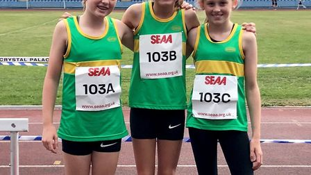 The Hunts AC Under 13 Girls team are, from the left, Eliza Mardon, Evie Flockhart and Ella Watson. P