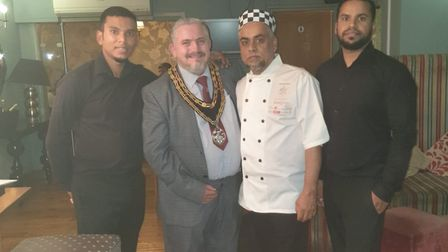 Royston town mayor Councillor Robert Inwood with Amran Hussain and members of his team. Picture: Yuv