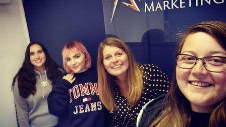Founder of Amber Mountain Marketing, Emma Ellis, with some apprentices. Picture: Submitted by Emma E