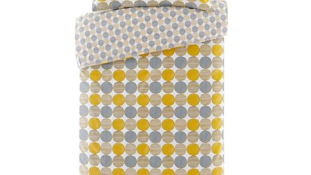 Mustard and grey bedding set from the Argos Home range. Picture: PA Photo/Handout.
