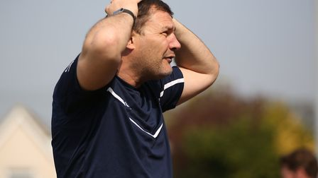 Royston Town manager Steve Castle holds his head in the game between Royston Town v Biggleswade Town
