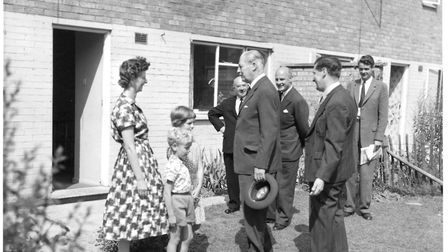 Residents pictured outside their new homes. Picture: Archant