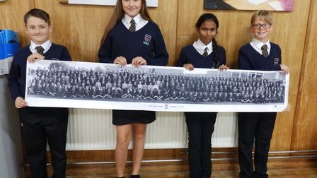 As part of the celebrations, a whole-school photo of the first students has been presented by four o