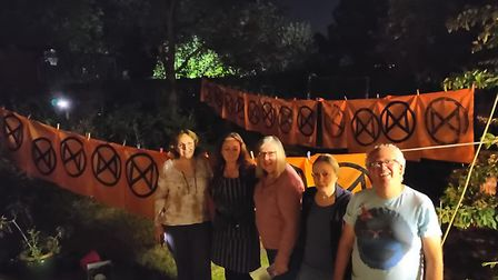 Extinction Rebellion St Albans working through the night to create protest flags. Picture: Clare Har