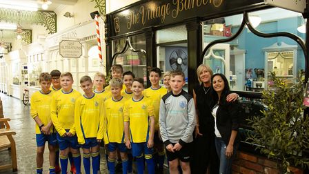 St Albans City Youth FC outside the Village Barber Shop on High Street. Picture: DaraChristineSilva