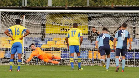 St Neots Town goalkeeper James Philp is beaten from the penalty spot as they bowed out of the FA Tro