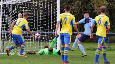 Sam Goode strikes for St Neots Town during their FA Trophy tie at Carlton Town. Picture: DAVID R. W.