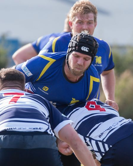 St Ives man Matt Wood is stopped in his tracks by Leighton Buzzard opponents. Picture: PAUL COX