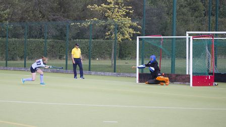 Tanya Sergeant tucks away a penalty flick for St Neots Ladies 1sts in their draw with North Norfolk.