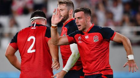 England's George Ford celebrates Elliot Daly's try during the 2019 Rugby World Cup Pool C match at T