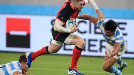 England's Elliot Daly on his way to scoring his side's second try during the 2019 Rugby World Cup Po