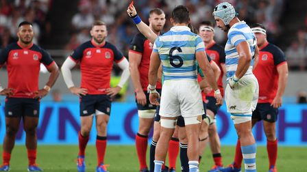 Referee Nigel Owens (Wales), issues a red card to Argentina's Tomas Lavanini (right) during the 2019