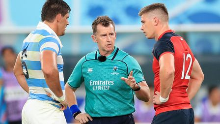 Referee Nigel Owens speaks with Argentina's Pablo Matera (left) and England's Owen Farrell during th