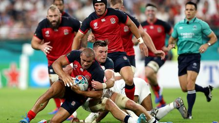 England's Jonathan Joseph is brought down during the 2019 Rugby World Cup match at the Kobe Misaki S