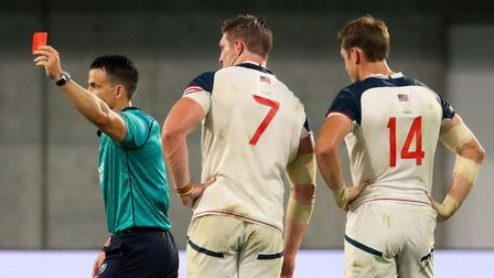 Referee Nic Berry shows USA's John Quill (centre) the card during the 2019 Rugby World Cup match at