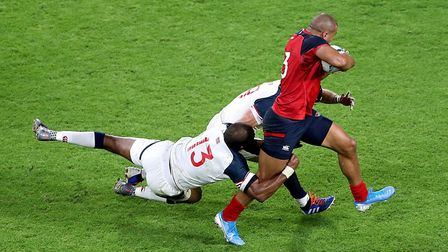 England's Jonathan Joseph in action moments before Joe Cokanasiga scores his side's fourth try durin