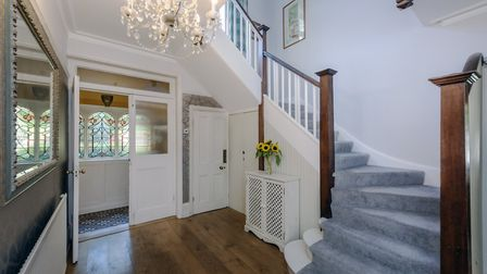 The ground floor opens to a grand central hallway with sweeping staircase. Picture: Frost's