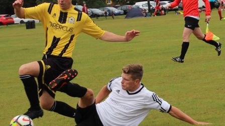 Mitchell Pagett of Beehive goes past a grounded Snug Bar player. Picture: BRIAN HUBBALL