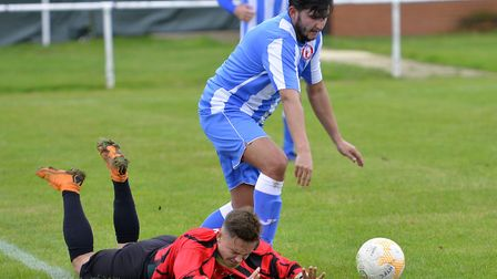 Jakub Sulima is floored as Huntingdon Town lost in the FA Vase to Frenford. Picture: DUNCAN LAMONT