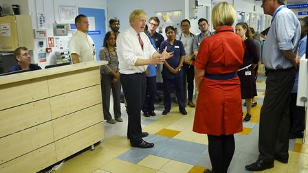 Prime Minister Boris Johnson speaks to medical staff during his visit to Watford General Hospital, f