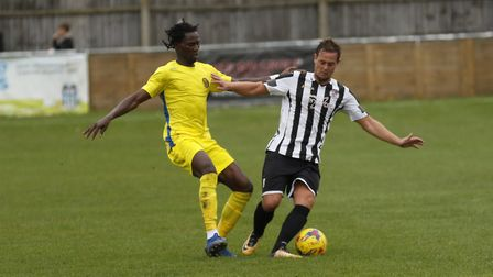 St Ives Town defender Mark Coulson does battle with Peterborough Sports striker Maniche. Picture: LO