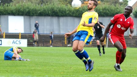 Sam Merson in action for St Albans City against Eastbourne Borough as Joe Iaciofano suffers an ankle