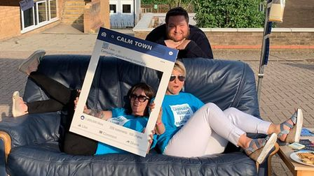 """Jo Grimmer (on right) Laura Bridgens, and Phil Pope on the """"calm couch"""" which encourages people to s"""