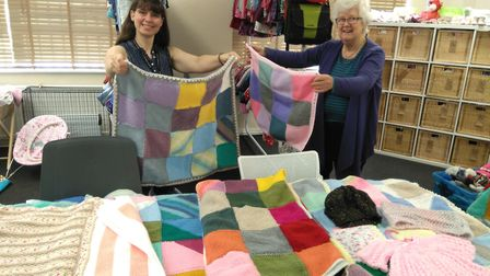 Susan David from Redbourn Women's Institute presenting a collection of 15 blankets to Rebecca Metcal