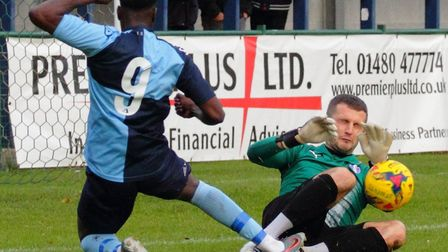 St Neots Town striker Alan Musoke is denied during their clash with Daventry Town. Picture: DAVID R.