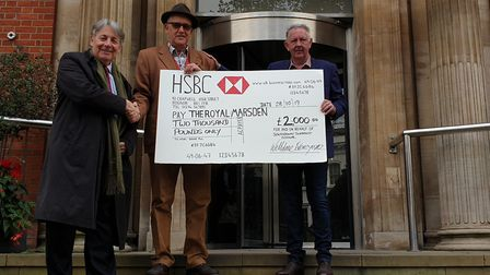 Charles Alexander from The Royal Marsden Cancer Charity, Irvine Hunter and Tony Hedigan with money r