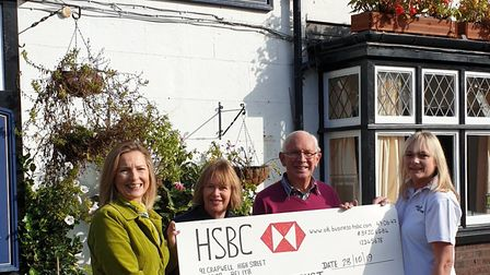 Di McCurley, Diana Brindlecombe, Nick Luckett and Sarah Rider with money raised at Southdown Festiva