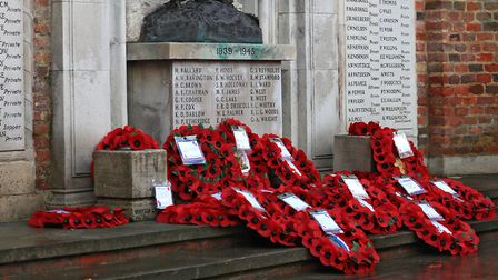Wreaths at the Royston War Memorial during last year's Remembrance Sunday service. Picture: KEVIN RI