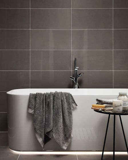 The bathrooms have elegant grey ceramic wall and floor tiles. Picture: Fairview New Homes