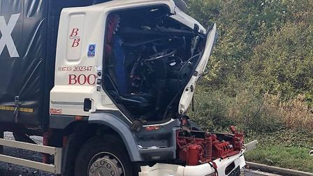 A driver was cut free from his cab following the collision. Picture: CFRS