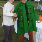Redbourn Conkerthon winner Adele Irwin is presented with her trophy by Conker King Dave Jakins.