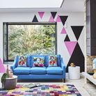 Painted triangles on the walls echo colours in the rug for a playful style story. Villa Multi Blocks