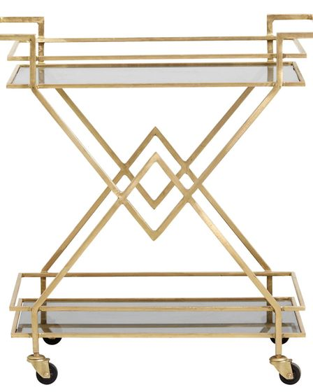 Make a party point: Fabulous Golden Drinks Trolley, £485, Audenza, boasts sharp lines and sassy good