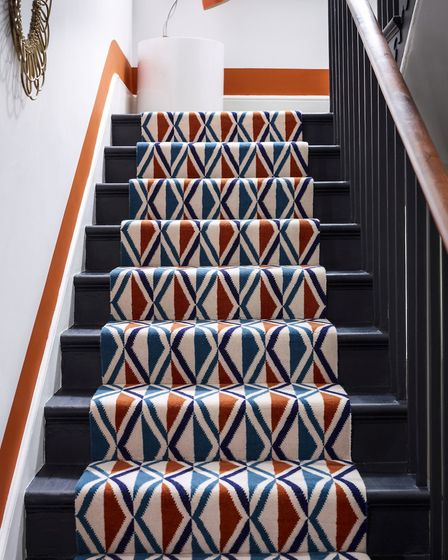 Step up to the style: Stair treads painted in a deep blue echo the navy detail in this Grosvenor Wil