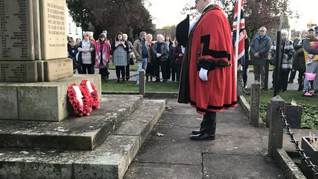 St Neots mayor Cllr Gordon Thorpe laying his wreath at the war memorial in Eaton Socon