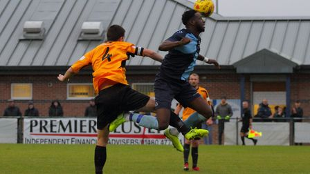 St Neots Town striker Alan Musoke gets off the ground against Aylesbury United. Picture: DAVID R. W.