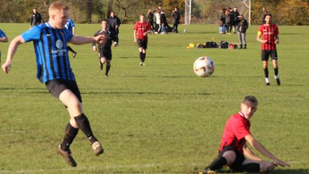 Giles Cunnington scores for Harpenden Colts Reserves against Forza Watford. Picture: BRIAN HUBBALL