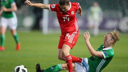 Wales' Hayley Ladd is tackled by Northern Ireland's Lauren Wade during their game at Newport in Sept