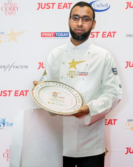 Chef Bakhtiar Murshed with the award trophy for Fusion Foods in Markyate. Picture: Supplied