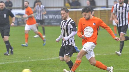 Soham Town Rangers full-back Callum Russell on the ball against St Ives Town. Picture: DUNCAN LAMONT