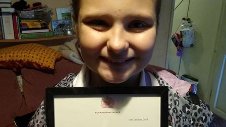 Katie Anne Buckenham with her letter from the Queen. Picture: CONTRIBUTED