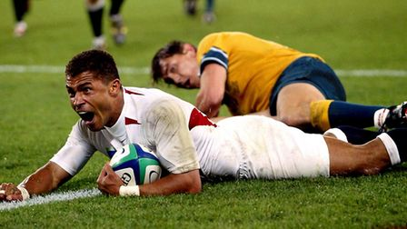 Jason Robinson celebrates scoring his try for England against Australia in the 2003 Rugby World Cup