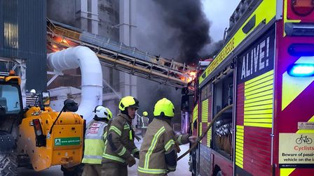 Crews from Cambs and Herts tackling a large fire on the outskirts of Steeple Morden. Picture: Perry