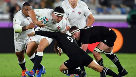 England's Jamie George is tackled by New Zealand's Aaron Smith during the 2019 Rugby World Cup Semi
