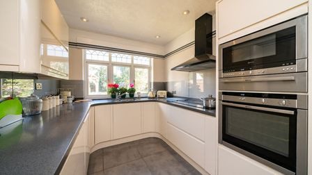 The kitchen has an induction hob and extractor fan, built-in oven and microwave, built-in dishwasher